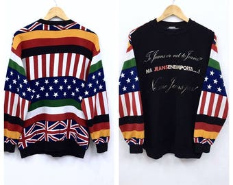 5414ae7927bf35 Vintage Moschino Jeans Misura All Over Print Flag USA Germany Italy Made  Crew Neck Sweatshirt