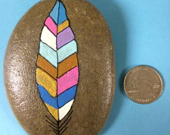 Feather painted stone