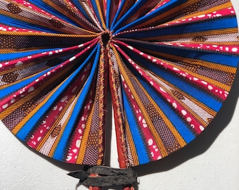 Blue pink brown white Kente Ankara africa wedding favor ethnic print fabric round windmill style handmade hand fan with leather trim folding