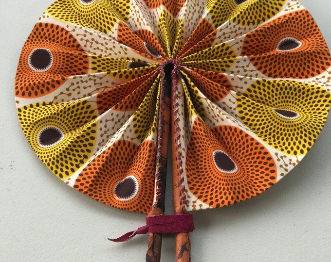 Orange yellow Nsubura Ankara african wedding favor ethnic print fabric round windmill style handmade hand fan with leather trim folding