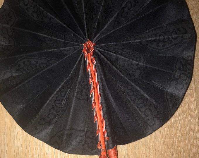 Solid Black Ankara gye nyame  african wedding favor ethnic print fabric round windmill style handmade hand fan with leather trim folding