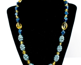 Unique interesting necklace, combined with two colors - turquoise blue and yellow.