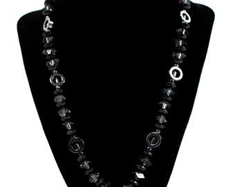 Unique black necklace with a nice pendant.