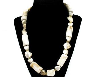 Unique necklace beige of stone