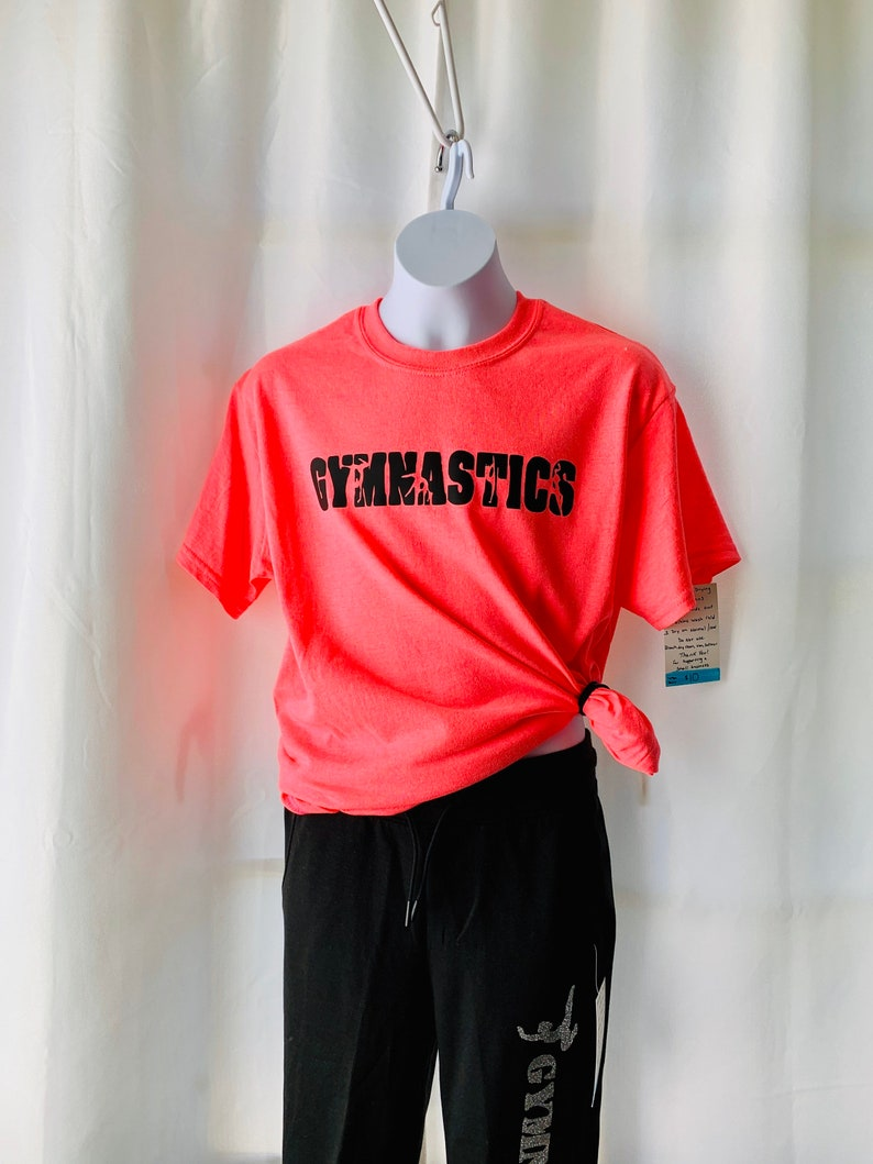 Gymnastics top with gymnast silhouettes inside letters