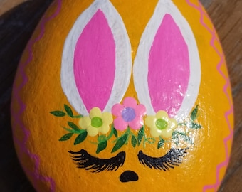 Orange Easter bunny painted rock with flower crown