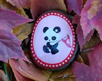 Little panda with heart flag painted rock