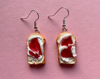 Toast earrings with cream cheese and strawberry jam. Polymer clay earrings, handmade, fun and light.