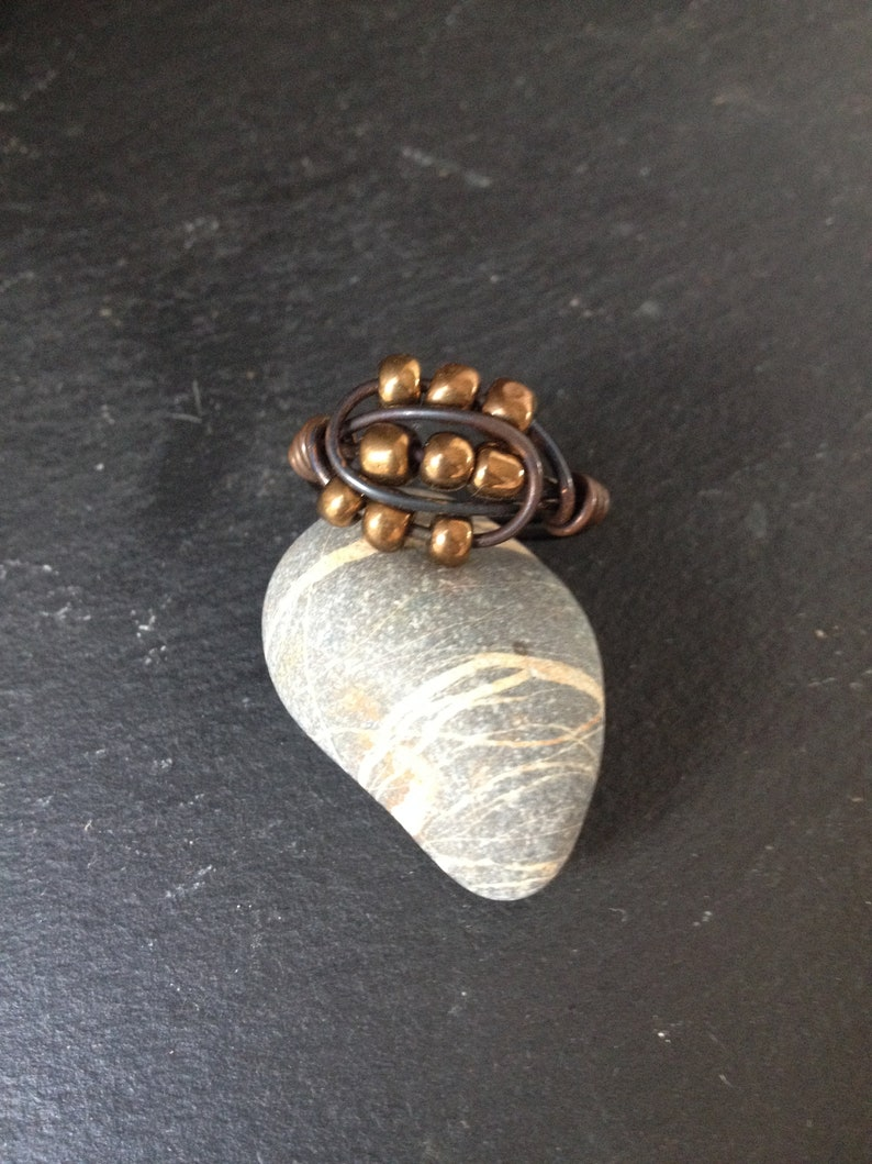 Copper ring with patina and bronze goldish colour beads