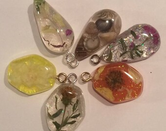 Resin embedded dried flower and seashell pendants