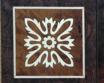 Coasters of marquetry at root of American walnut and Sycamore