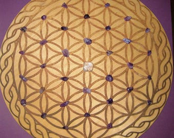 Crystal grid flower of life board with gemstones