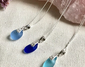 Sea glass and sterling silver pendants