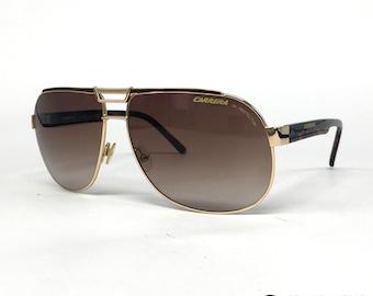 f2ccced8d4d69 NOS Carrera Dakar gold vintage sunglasses large