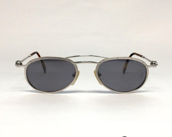 aed8da7e7dbab9 NOS Aston Martin AM32 vintage zonnebril Titanium gemaakt in Duitsland 80  s  Medium