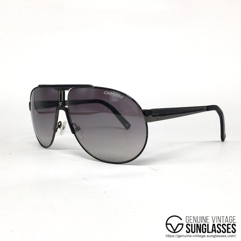 caf608761bd8 NOS Carrera PANAMERIKA sunglasses black Italy 90's Large | Etsy