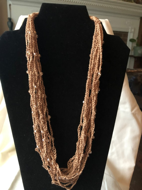 100/% cotton thread with Chengmu 4mm Bicone  glass beads. Crocheted beaded multi strand necklace