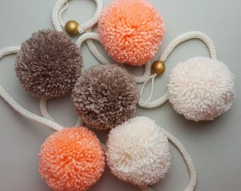 Pom pom garland pastel wool big pom poms on a knitted cord