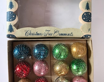 Vintage miniature mercury glass Christmas ornaments wrapped in mesh