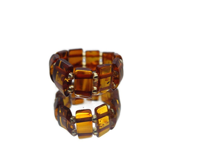 Natural Baltic amber ring on silicone