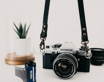 Leather camera strap. Color Black. Handmade in Italy with genuine Tuscany Leather.
