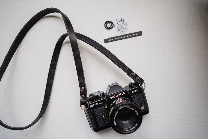 Leather camera strap. Color Black. Handmade in Italy with image 0