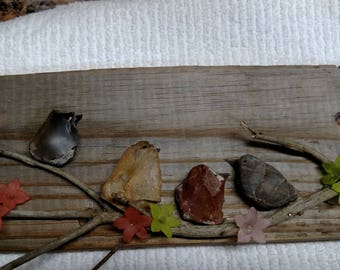 Birds in the Tree made on reclaimed pallet wood with rocks and tree limb
