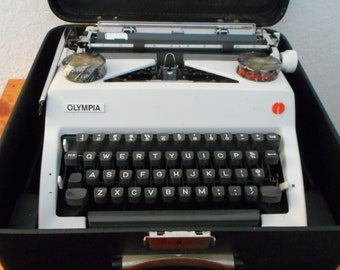 Vintage 1970's Olympia SM9 Deluxe typewriter with case, ribbons, and more, vintage typewriters, vintage Olympia typewriters, vintage SM9