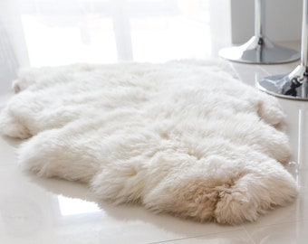 Natural Sheepskin Rug in off White colour. Single sheepskin pelt. Various Sizes