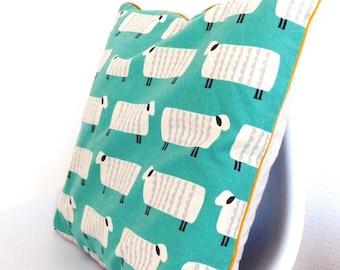Piped cushion sheep pattern