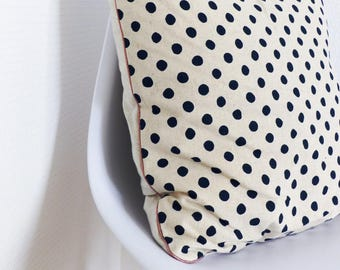 Decorative cushion is piped with blue dots