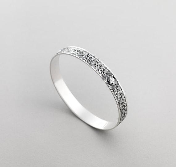 Isle of Iona. A Sterling Silver Bracelet by Aosdana Broad Zoomorphic Open Bangle Dark Finish
