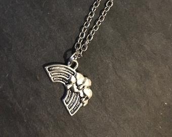 Silver rainbow pendant on silver coloured chain