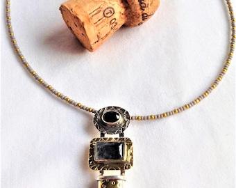 Sterling silver , brass, tourmalated quartz, onyx healing necklace