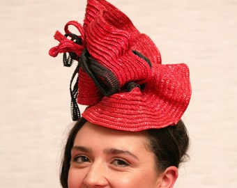 Red hat, red and black hat, red statement hat, red race hat, red headpiece