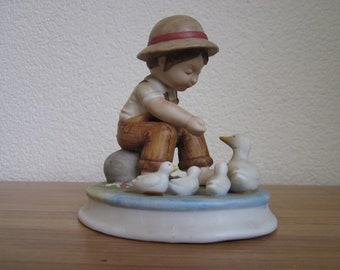 Figurine Boy with ducklings of Gretchen ceramics