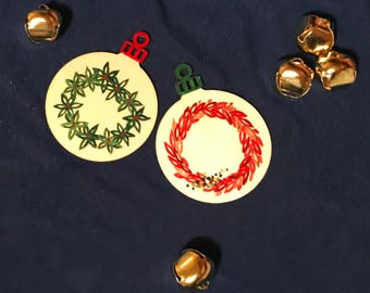 Handprinted Wooden Ornaments Decorated with Wreaths