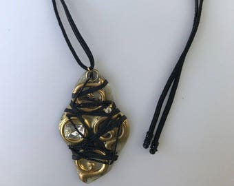 Resin and metal pendant