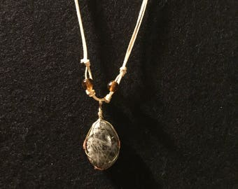 Wire wrapped grey stone pendant
