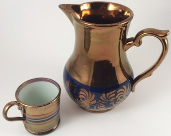 c21cc076a56 Large copper luster blue banded pitcher and child s mug