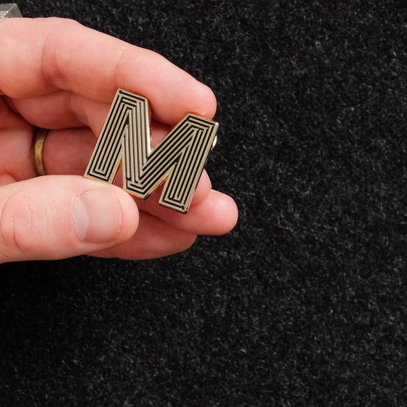 Labyrinth Letters  M  Enamel Pin image 0