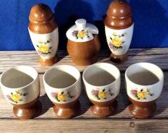 Vintage set eggcups, salt and pepper shakers, condiment jar. Retro wooden and ceramic.