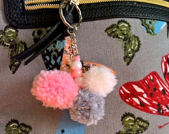 Bag charm, pom pom and beaded charm. Pink, white and grey.