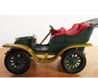 Toy car Vintage Gama German Opel, Dark green, classic car style.