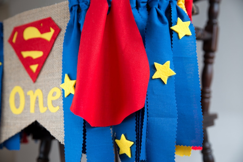 Superman baby banner with blue ribbons with stars and red cape makes cute party decoration for one year old baby boy High chair bunting.