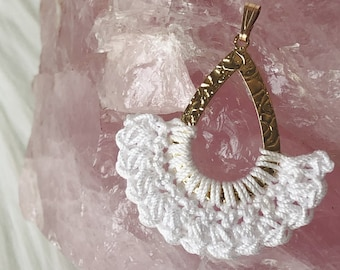 Women's crocheted hammered brass pendant with white lace yarn