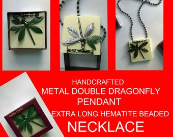 An unusual gun metal grey double dragonfly pendant necklace.Comes gift boxed