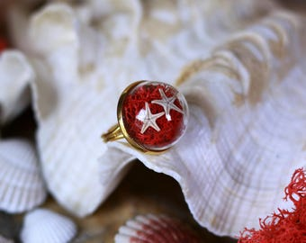 Pretty starfish on bed lichen, here is a ring that would not deny the little mermaid, adorable, is not it?