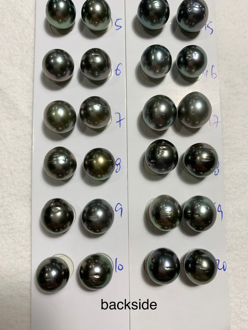 has blemishes 11-12 MM High Luster Natural Color with PeacockGreenGrey Tahitian Cultured pearl sold by pair Tahitian pearls