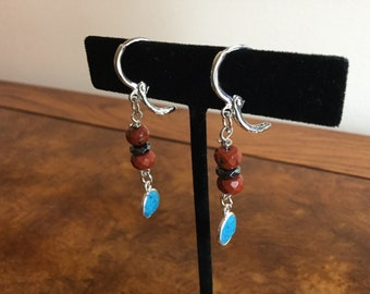 Turquoise, red jasper, and 925 sterling silver earrings.